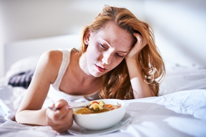 woman tired and sick eating foods with lectins